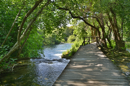 waterscapes: A wooden walkway on the River Krka in Krka National Park, Sibenik-Knin County, Croatia. It is part of the    part of the 1900m Skradinski Buk Waterfall trail Stock Photo