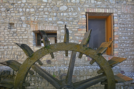 water wheel: An old historic wooden water wheel in the north east Italian town of Valvasone in Friuli Venezia Giulia