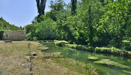 tributary: The landscape near Roski Slap waterfall showing a small tributary of the River Krka in Krka National Park, Sibenik-Knin County, Croatia.