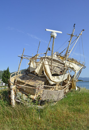 An old derelict beached boat outside the Croatian village of Blace.