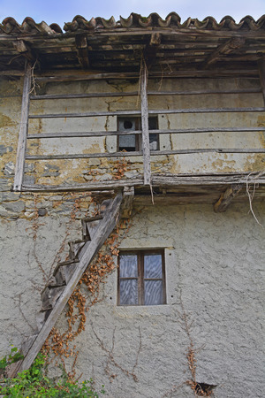 abandoned farmhouse abandoned farmhouse: An old derelict building in the small Italian village of Oblizza, Friuli Venezia Giulia. Stock Photo