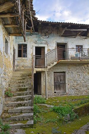 derelict: An old derelict building in the small Italian village of Oblizza, Friuli Venezia Giulia. Stock Photo