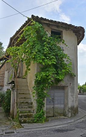 abandoned farmhouse abandoned farmhouse: An old historic farm house in the small Italian village of Vernasso in Friuli Venezia Giulia, north east Italy. Stock Photo