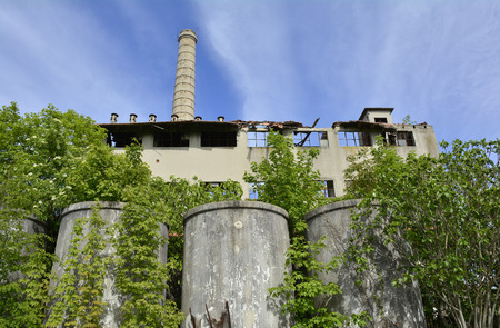 tannins: A derelict factory outside Cividale del Friuli, Italy. The factory used to produce tannins obtained from chestnut wood (castanea sativa) which was used in the tanning of leather.