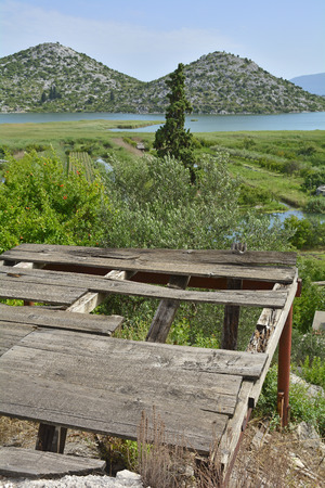 neretva: The landscape near the village of Blace in the coastal Dubrovnika Neretva county of Croatia. A disused wooden platform can be seen in the foreground.