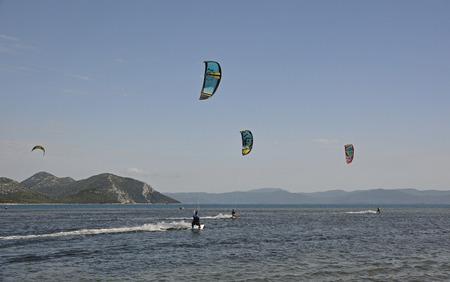 kite surfing: Blace, Croatia - June 18th 2016. Students practice kite surfing at a kite surfing school near the coastal Croatian village of Blace.