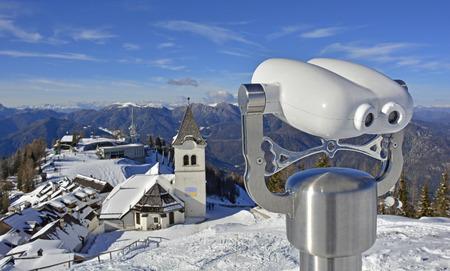Viewing bincoulars near the small village and ski resort of Lussari on Monte Lussari, Friuli Venezia Giulia, north east Italy. Stock Photo