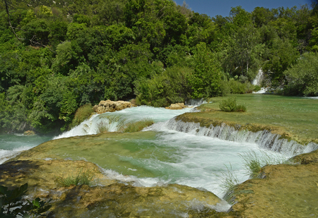 Skradinski Buk waterfall on the River Krka in Krka National Park, Sibenik-Knin County, Croatia. The  waterfall consists of travertine barriers and a total of 17 different water falls, it is considered