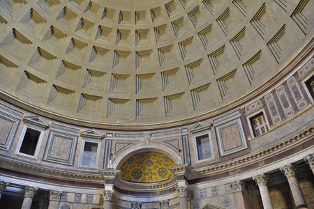 The landmark Pantheon in Rome, Italy. Originally a temple, and now a church, it has a coffered concrete dome which has a central opening or oculus to the sky.