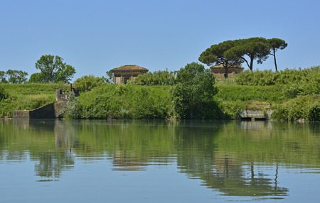 waterscapes: The Tiber River as it flows through Ostia Antica near Rome, Italy