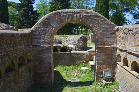 The ruins of Via Delle Tombe in Ostia Antica near Rome, Italy. It was Romes ancient port before the river silted, it fell into decay with the end of the Roman empire and was abandoned in the 9th century
