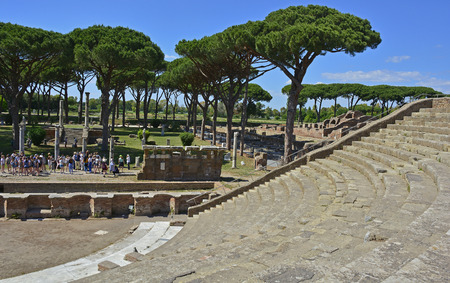 Ostia Antica, Rome - 27th May 2017. Tourists visit the ruins of the Theatre of Agrippa in Ostia Antica near Rome, Italy. It was Rome's ancient port before the river silted, it fell into decay with the end of the Roman empire and was abandoned in the 9th c