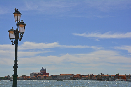 The island of Giudecca in the Dorsoduro quarter of Venice, viewed from the opposite side of the Giudecca canal. Il Redentore (Basilica del Redentore, or Chiese del Santissimo Redentore), designed by Palladio in 1577, stands out on the skyline.