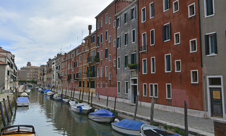 despite: Venice, Italy - July 26th 2017. A residential area in the Dorsoduro quarter of Venice. Despite it being peak season, the more residential back streets remain relatively quiet