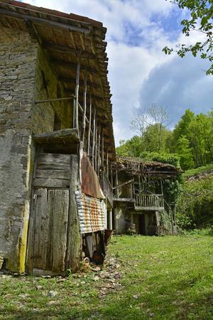 Derelict farm buildings in the small hill village of Iainich in Friuli Venezia Giulia, north east Italy