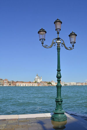 A view of the island of Dorsodoro in Venice taken from the island of Giudecca across the Giudecca Canal. The church of Santa Maria Della Salute (Saint Mary of Health) can be seen towering above the other buildings