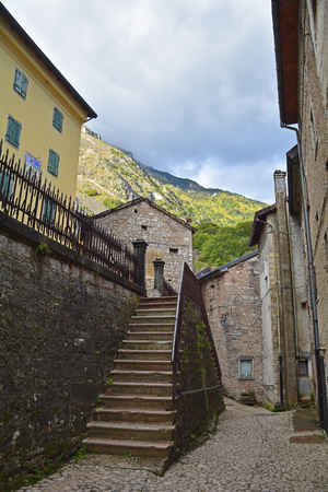 A small street in the hill village of Casso in Friuli Venezia Giulia, north east Italy. With a population now of only 35, the village is famous locally for having being evacuated following the 1963 Vajont Dam disaster.