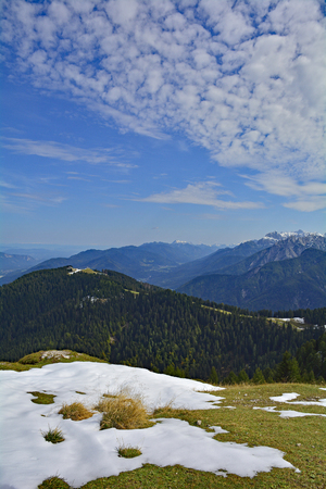 The view from Monte Lussari in Friuli Venezia Giulia, north east Italy in late September. The first snows have fallen but not enough to open the ski slopes yet. Stock Photo