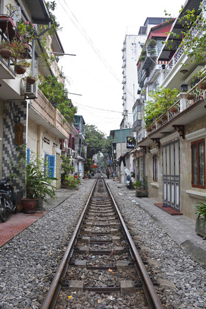 Hanoi, Vietnam - 14th December 2017. Houses on a residential street which is often referred to as Train Street in central Hanoi which has grown up around the north-bound train track
