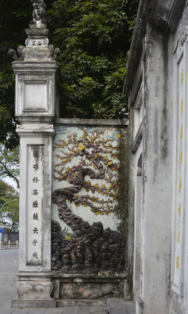 Hanoi, Vietnam - 16th December 2017. A wall outside the historic Quan Thanh Temple in the Ba Dinh district of Hanoi, Vietnam. The temple, also known as Tran Vo Temple, was built between 1010 and 1028