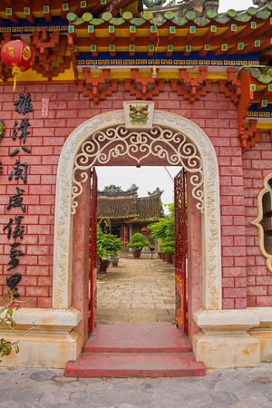 A view through the three entrance gate towards the Phuoc Kien (or Fukian, Fujian or Phuc Kien) Assembly Hall built in 1697 by Chinese merchants in the historic  listed central Vietnamese town of Hoi An