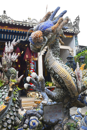 A pond depicting dragons in the grounds of the Cantonese Assembly Hall, also known as Quang Trieu, built by Cantonese merchants in 1885 in the historic UNESCO listed central Vietnamese town of Hoi An Stock Photo