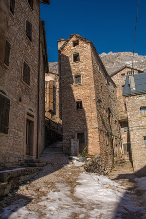 A street in the hill village of Casso in winter Friuli Venezia Giulia, north east Italy. With a population now of only 35, the village is famous locally for having being evacuated following the 1963 Vajont Dam disaster. Sajtókép
