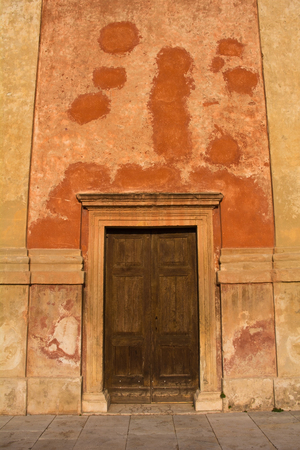 A church door in the historic town of Vittorio Veneto in the Veneto region of north east Italy