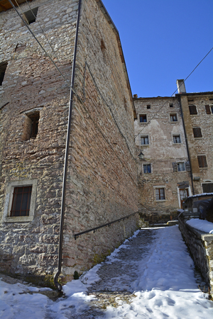 A street in the hill village of Casso in winter Friuli Venezia Giulia, north east Italy. With a population now of only 35, the village is famous locally for having being evacuated following the 1963 Vajont Dam disaster. Stock fotó