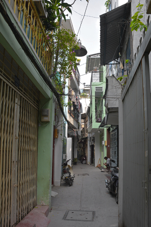 Ho Chi Minh City, Vietnam - 3rd January 2018. A small residential back street in the Tran Hung Alleys area of District 1 in Saigon.