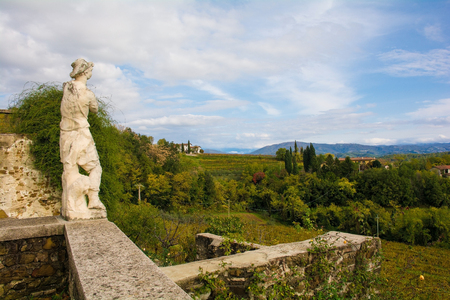The autumn landscape in the Collio vineyard area of Friuli Venezia Giulia, north west Italy, showing a statue from the historic Abbazia di Rosazzo Abbey