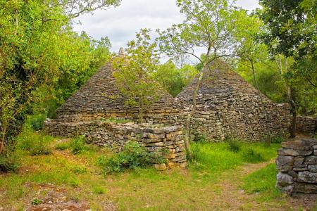 The Twin Kazuni (Kazuni Blizanci) near Vodnjan in Istria, Croatia. Kazuni are traditional dry wall shelters constucted for farmers and shepherds