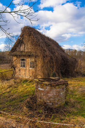 An abandoned traditional house in the small village of Suvoj in Sisak-Moslavina County, central Croatia. A well can be seen in the foreground