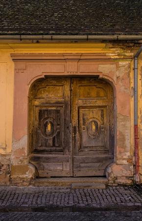 An old wooden door in Osijek, Osijek-Baranja County, Slavonia, Eastern Croatia