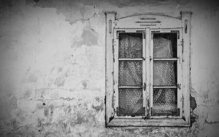 A window in an abandoned old house in the village of Cigoc in Sisak-Moslavina County in central Croatia Stok Fotoğraf