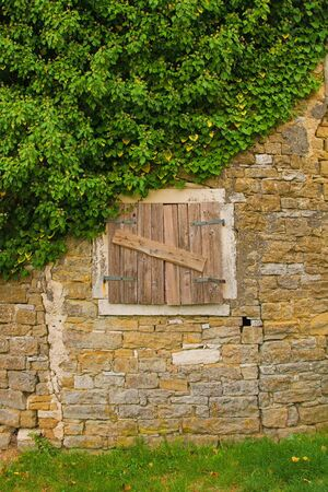 An old window in the historic hill village of Oprtalj in Istria, Croatia Stok Fotoğraf