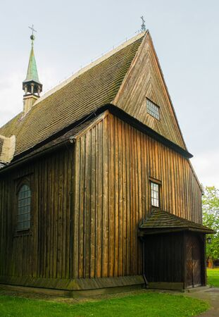 The historic St Bartholomew's Parish Church in Nowa Huta, Krakow. This wooden gothic church has a three nave body and dates from 1466 Stock Photo