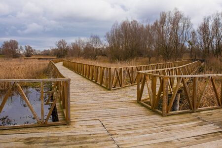 Wooden walkways in the Kopacki Rit Nature Reserve in winter in north east Croatia. Located by the Serbian border, close to the confluence of the Drava and Danube rivers, it is one of the largest and m