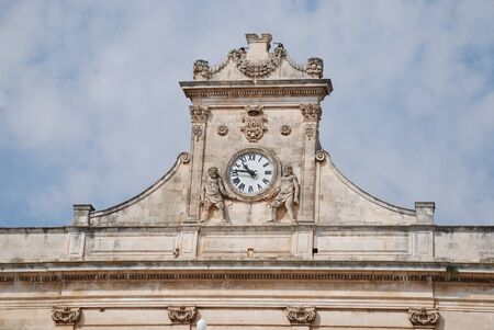 The clock on the historic Clock on Palazzo del Sedile in Matera, southern Italy