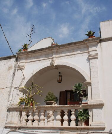 A balcony with plants in the southern Italian town of Ostuni ('The White City') Stok Fotoğraf