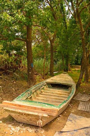 An old wooden fishing boat in the wetland area of Isola Della Cona in Friuli-Venezia Giulia, north east Italy