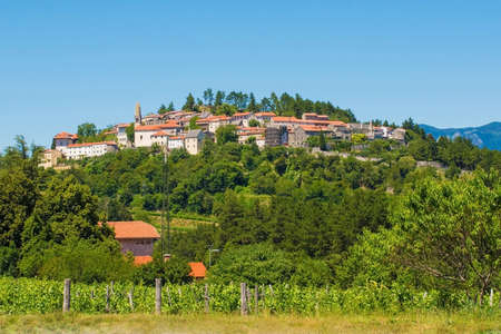The old historic hill village of Stanjel in the Komen municipality of Primorska, south west Slovenia. The distinctive lemon shaped tower of the church of St Daniel can be seen