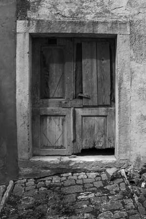 An old door in the historic hill village of Oprtalj in Istria, Croatia