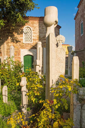 The historic muslim cemetery in the grounds of Little Hagia Sofia mosque in the Kumkapi district of Istanbul, Turkey