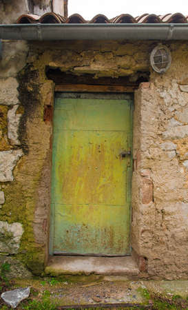 An old door in a derelict building in the historic hill village of Stanjel in the Komen municipality of Primorska, south west Slovenia.