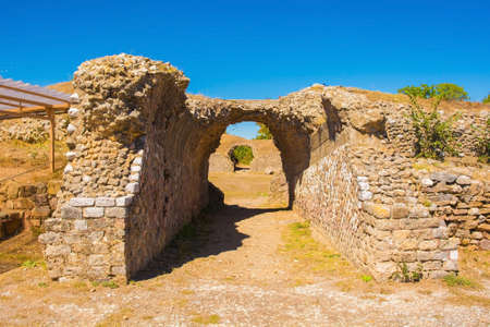Grosseto, Italy - September 4th 2020. One of the barrel vault entrances to the ruins of the amphitheatre in Roselle or Rusellae, an ancient Etruscan and Roman city in Tuscany. It stands on the northern hill of the ruins and dates from the 1st century AD