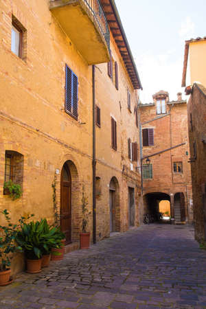 A quiet residential back street in the historic medieval village of Buonconvento, Siena Province, Tuscany, Italy