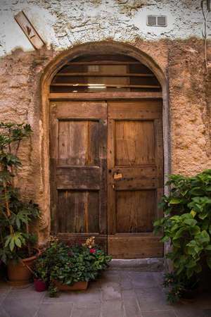 A door in an old building in the historic medieval village of Scansano, Grosseto Province, Tuscany, Italy