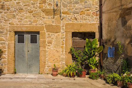 Doors in a residential building in the historic medieval village of Poggio Capanne near Manciano in the Grosseto Province of Tuscany, Italy Stok Fotoğraf