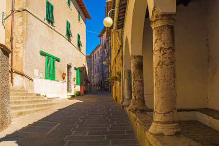 A quiet residential street in the historic medieval village of Batignano, Grosseto Province, Tuscany, Italy